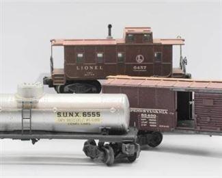 Lionel Trains No. 6454 P.R.R. Box Car, No. 6457 Caboose and No. 6555 Sunoco Tank Car - All in Original Boxes