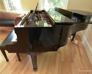 Yamaha C2 Grand Piano  Accepting offers 1999 High gloss ebony finish. Exterior in excellent condition. All keys function properly. Well-maintained. Serial number indicates the piano was made in Japan in 1999.