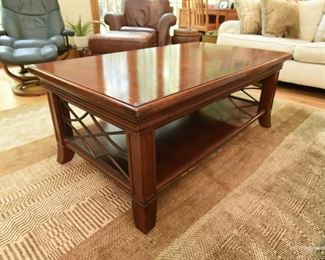 """Coffee table  $95 Wood with iron details. Bookmatched top in form of diamond. 4'2"""" long x 1'8"""" tall x 2'4"""" wide"""