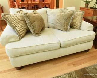 """Off-White Loveseat  $100 Some wear. There's a pull on one of the cushions as shown. 6' x 3' x 3'8"""""""