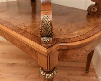 Henredon Tiered Side Table  $495  Made of olive and burled ash wood, in the French Empire / Neoclassical style. This piece is in excellent condition. H 30 in. x W 34 in. x D 22 in.