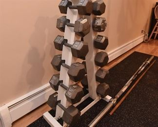 Solid Hex Dumbell Set with A-Frame Rack  $450 Six pairs of weights are 25lbs, 30lbs, 35lbs, 40lbs, 45lbs, 50lbs.