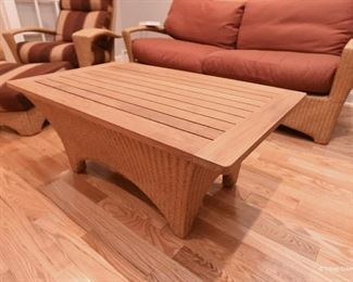 Wood-top wicker coffee table $125 For indoor or covered porch use.