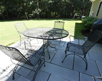 Oval Iron Table with Four Chairs  $275