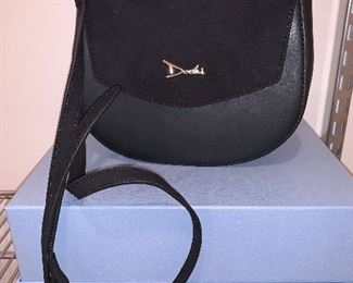 Black leather handbag in excellent condition $450