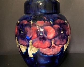 Moorcraft Pottery Ginger Jar, circa 1920.  It is 11  inches tall  (about 10 inches with the lid removed) and about 9 inches wide.   Pansy pattern, signed by William Moorcroft and marked 'Made in England' since it was made to be exported to the USA.   Excellent Condition.   This is an Online Auction that runs July 27, 2020 to August 3, 2020.   (Photos by BC)