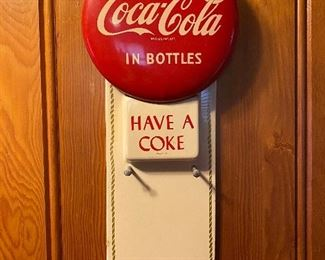 Vintage 1950's Coca Cola metal button calendar holder.    This is an Online Auction that runs July 27, 2020 to August 3, 2020.    (Photos by BC)    Click on this link to register and to bid  https://theoakauctions.hibid.com/catalog/226003/corsicana-johnson-estate-sale/