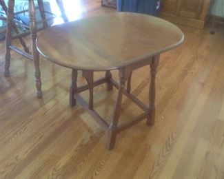"Drop side end table...measures30"" long x 34"" high x 23"" wide.   Measures 14"" long with sides down.   Presale for $45"