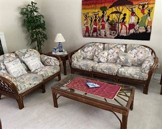 Rattan sofa, love seat, and tables  plus nice African cloth print