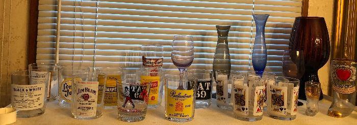 Booze label glasses, colored glass vases - big purple one on far right is Italian