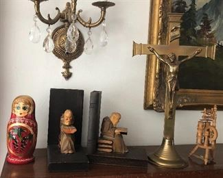 Russian nesting doll, German wooden monk bookends, tall brass crucifix, mini spinning wheel (N.B. Brass sconce with crystals is not for sale - it's part of house)