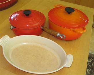 "$60.00, Three le Creuset bakeware , 9 & 8"" kettle, shows wear"