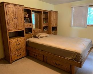 Blackhawk Furniture Company - 4 Bedrooms with this Dresser/Bed/Drawers/Cabinet Unit.