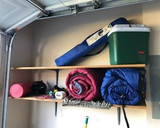 sleeping bags, foam roller, cooler, camping chair