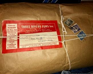 Unopened rolls of leather from Three Rivers Furs