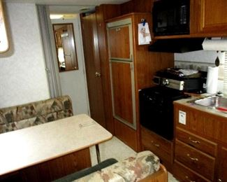 Kitchen-galley, gas stove, oven, freezer and fridge