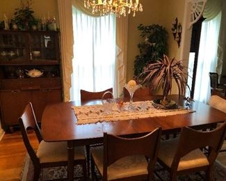 Mid century dining room table, chairs and matching buffet.