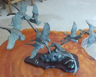 Bird sculpture - sorry, the family is keeping the cypress table