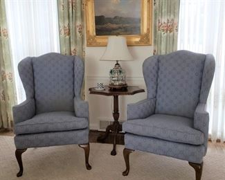 Pair of wing armchairs and mahogany table