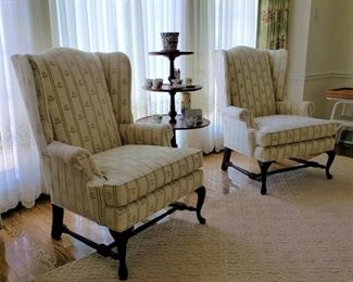 Pair of Harden Furniture Co. wing armchairs and a vintage mahogany tier table
