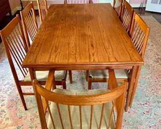 """$1500;MCM teak dining table made by J.L. Moller (made in Denmark). Two self-storing leaves. 71""""L x 41""""W x 28.5""""H.  Fully extended table measures 117""""L (each leaf is 23""""L). CHAIRS ARE SOLD!"""