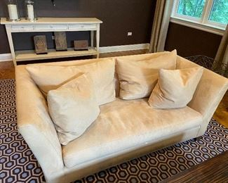 We have a pair of these.   Ultra suede sofas.  On smaller size.  Need cleaning  but does not hurt the integrity of these in perfect Condition  sofas.  75 L x 36 wide x  29 high.  $575 each