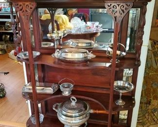 Antique mahogany etagere. Collection of silver plate pieces.