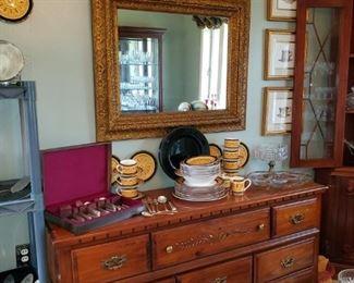 Dresser, silver plate flatware set, china, art work, & antique mirror.