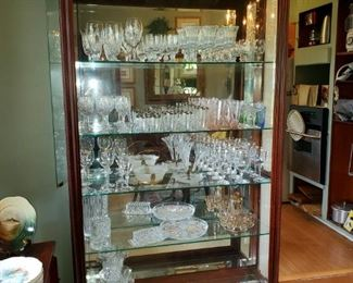 Large lighted China/curio cabinet. Top & bottom doors on both sides.  Crystal & cut glass