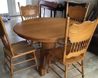 Beautiful Solid oak table and 4 chairs.