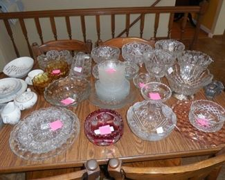 Variety of crystal bowls and platters.  Some Fostoria Americana.