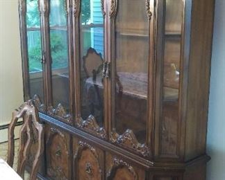 The Masterpiece!  Finest Bold Hand Carved Hardwood French Ambassadors style Lighted China Cabinet or China Closet!  Glass Shelves!  Two Pieces for easy transport by your local Football Players.  C u at Thanksgiving!!