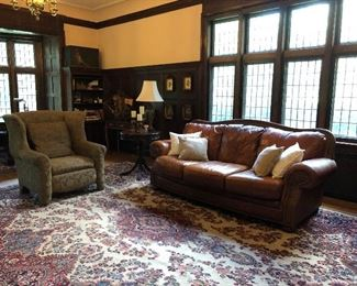 """Hand Knotted rug """"Kirman"""" (made in Iran), leather sofa"""