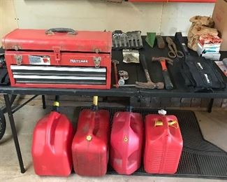 Craftsman toolbox full of tools and gas cans
