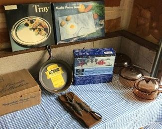 Pots and pans, cutting boards, and set of gold cutlery