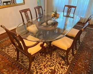 French Empire influenced style dining set made in China.  The owners purchased this  set in Abu Dhabi and shipped it back to Texas when they moved back.   The set has two arm chairs and six side chairs.