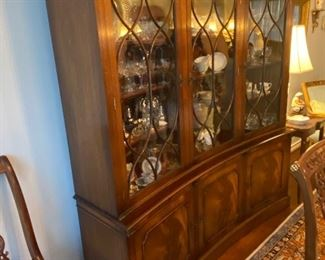 Unique Concave English burled mahogany breakfront china cabinet.   This was shipped to Texas from England when the family moved back to Corsicana in the early 2000s.