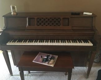 . . . a beautiful Grinnell's piano in walnut