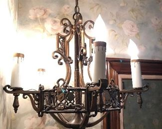 One of three 1930s brass chandeliers