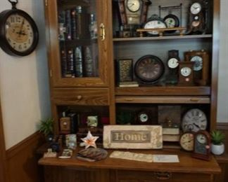 Reproduction Hoosier style cabinet with clocks and decor