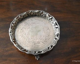 """Small Silver footed coaster   $65 4.25"""" round, .5"""" tall. South American hallmarks"""
