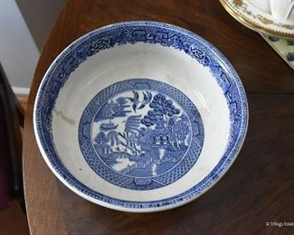 """Blue Willlow Footed Bowl $22 Short hairline crack in base. Crazing and stains on inside of bowl. 9"""" diameter, 4.75"""" tall"""