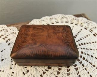 """Embossed leather box $12 4.5"""" x 3.5"""" x 2"""" Leather is continuous on back side to act as a hinge for the lid."""