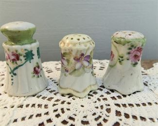 """Three porcelain painted hat pin holders. The tallest is 3""""  $12"""