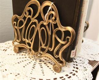 "Expanding brass book rack  $25 9"" x 6""  expands to 14.5"" long"