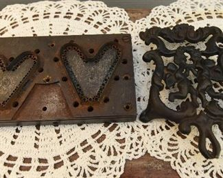 """Die cut jig for side by side hearts  SOLD Cast iron figural trivet $4 6.25"""" x 4.5"""". The end of the handle has a piece broken off."""