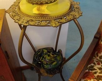 agate and brass table. vaseline basket and artglass.