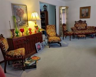 a general look of the living room with an eclectic assortment of treasured items.