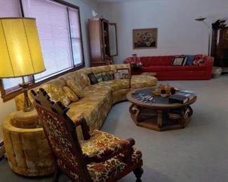 overview of livingroom. mid-century davenport and red velvet couch.