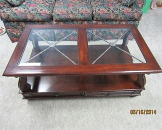 Glass-topped coffee table from Art Van. Shelf underneath, two drawers that can be opened from either side